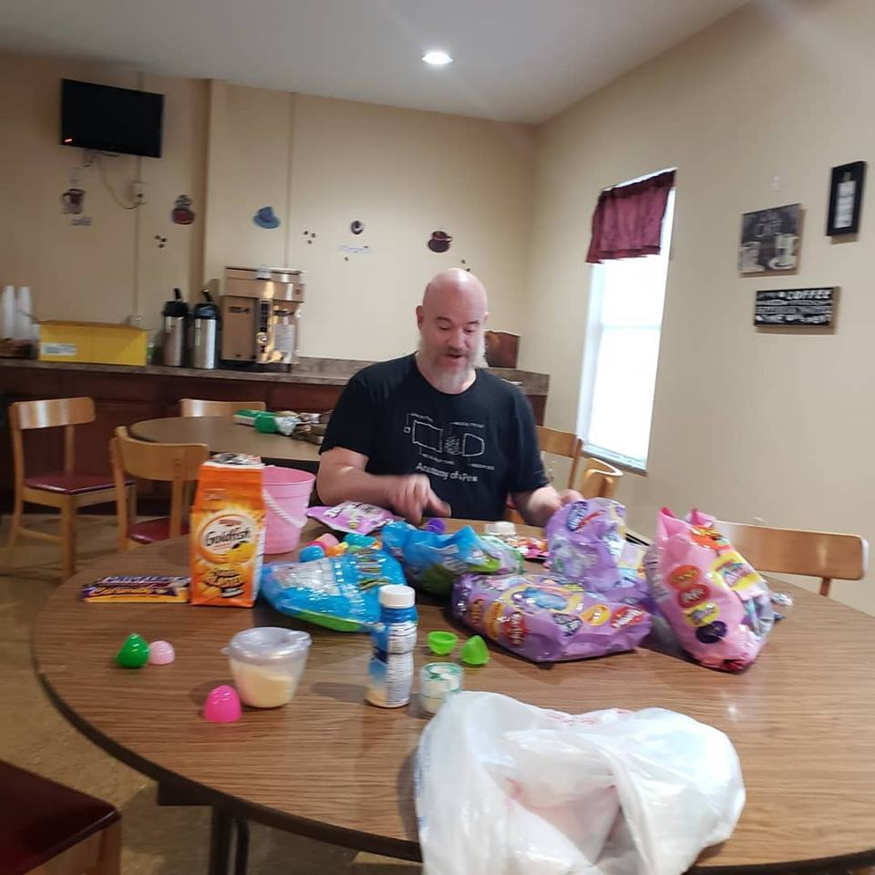 Pastor Josh helping fill eggs